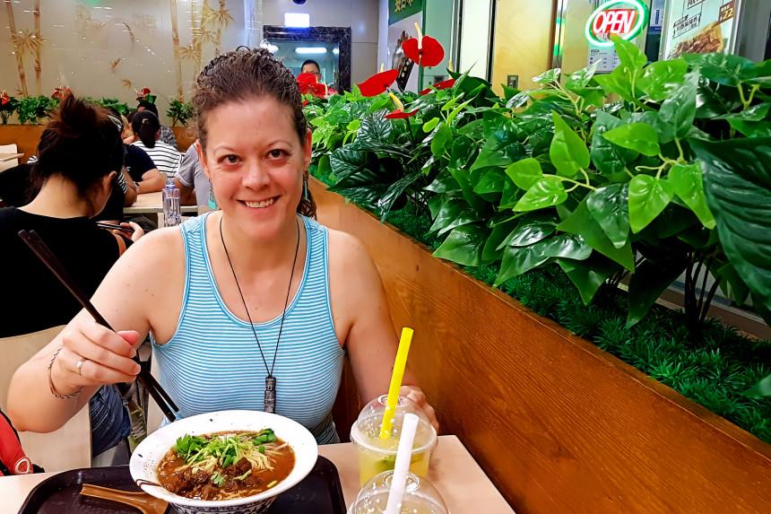 comiendo noodles en Pekin